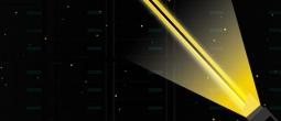 Lightsaber in front of data center server racks.